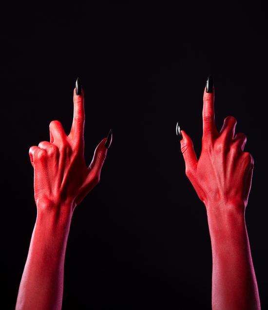 Unas carnaval bruja demonio manos rojas