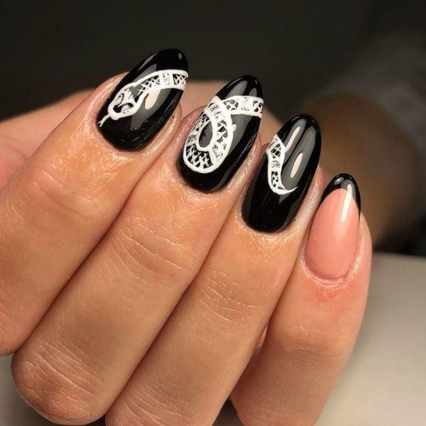 unas-decoradas-negras-adornos-blancos-instagram