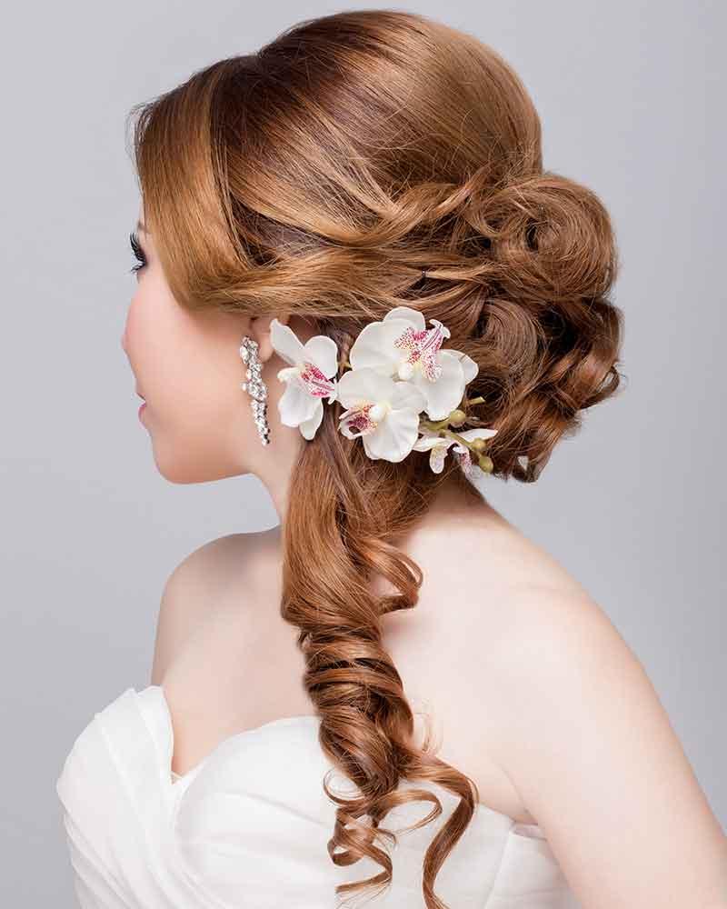 Peinado semicubierto novia orquídeas