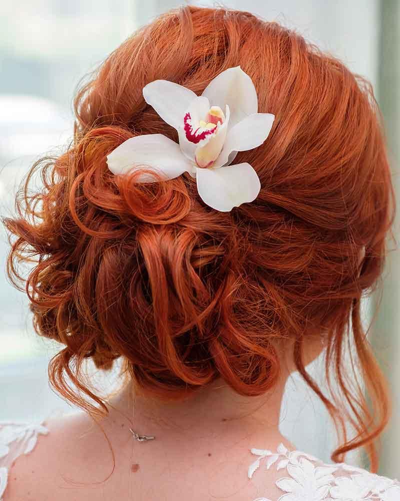 Peinado de novia con orquídeas