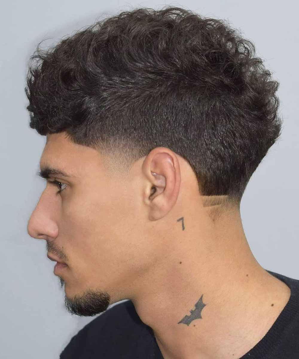 Cortes de pelo rizado corto hombre