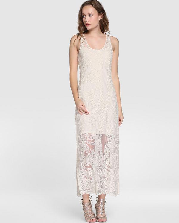2cdbc3e0ef Con fondo blanco y estampado floral muy colorido lleno de vida este vestido  largo con tiras que se cruzan al cuello y con tejido vaporoso es un vestido  muy ...