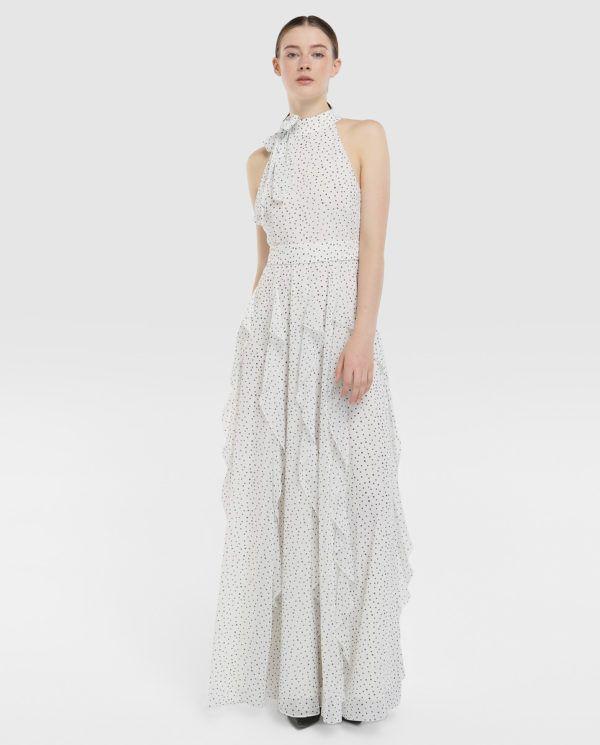 a0100030549 En este caso, comenzamos por este vestido de lunares con escote halter al  cuello y falda con volantes. Este diseño de Tintoretto está en 150 euros.