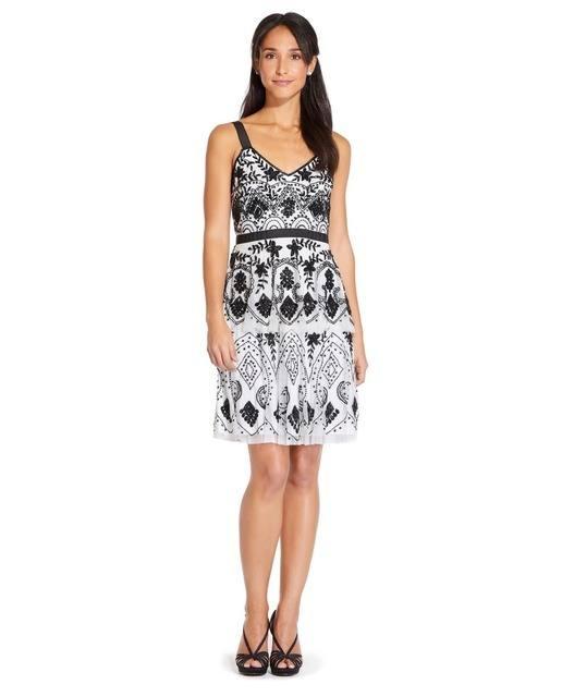 vestidos-negros-corto-sin-mangas-blanco-negro-adriana-papell-elcorteingles