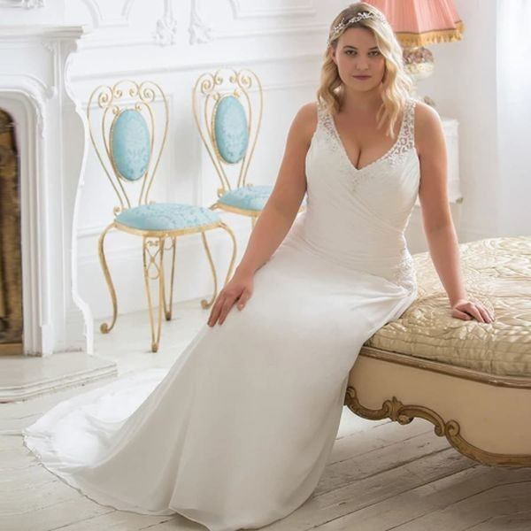 wedding-dresses-for-chubby-bride-sitting-on-bed-brides-xl-instagram